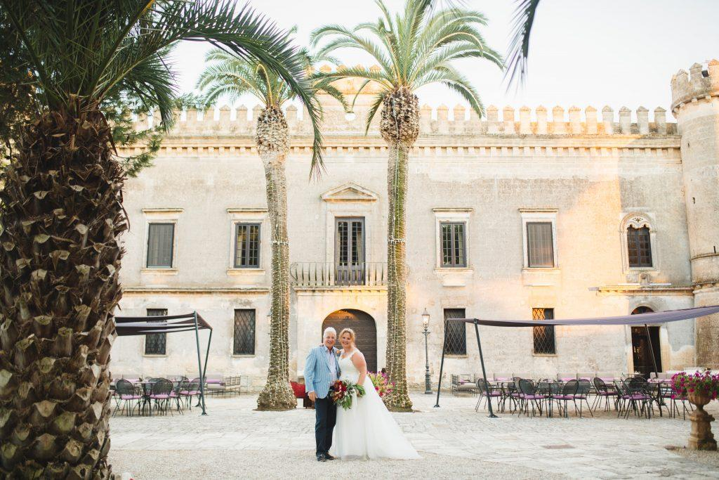 A stunning castle in South Italy makes for an amazing backdrop for photos and a great location for a destination wedding.