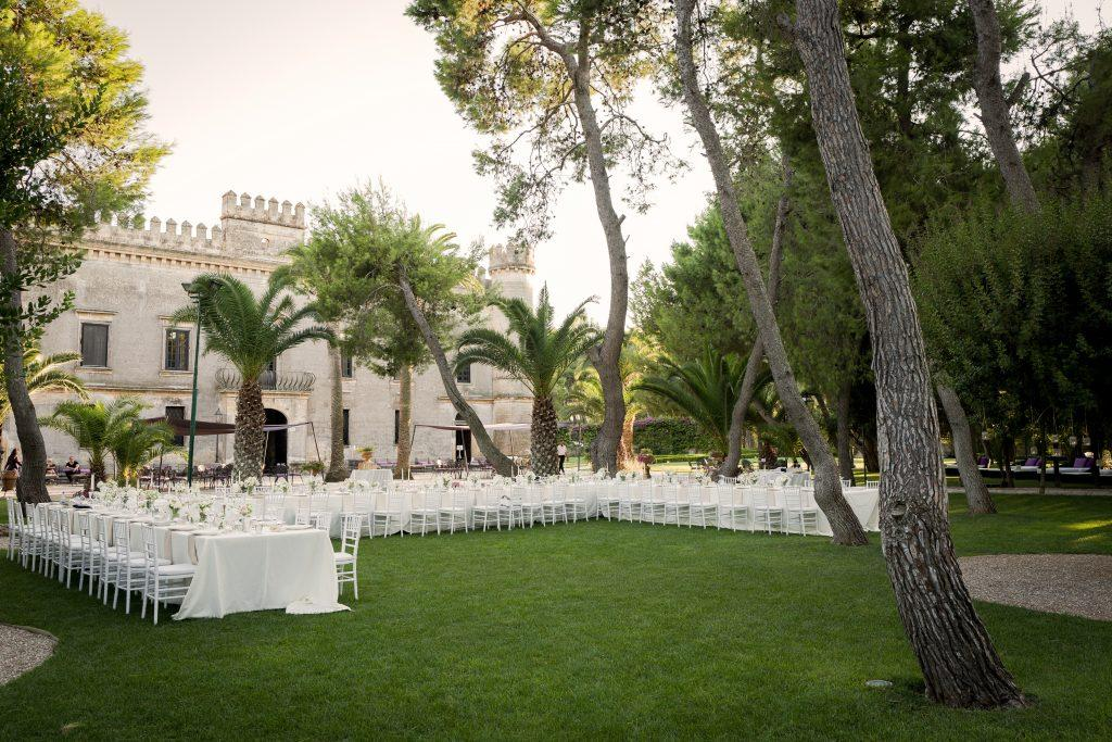 This couple enjoyed their destination wedding meal outside with a beautiful castle backdrop.